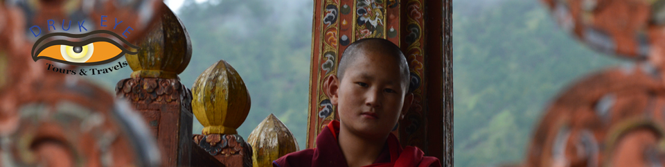 Young monk on the bridge of Punakha Dzong